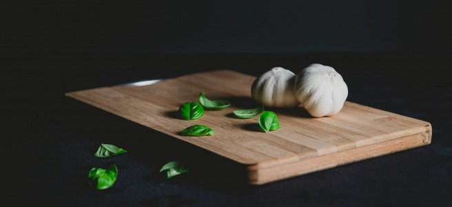 chopping board with garlic and basil