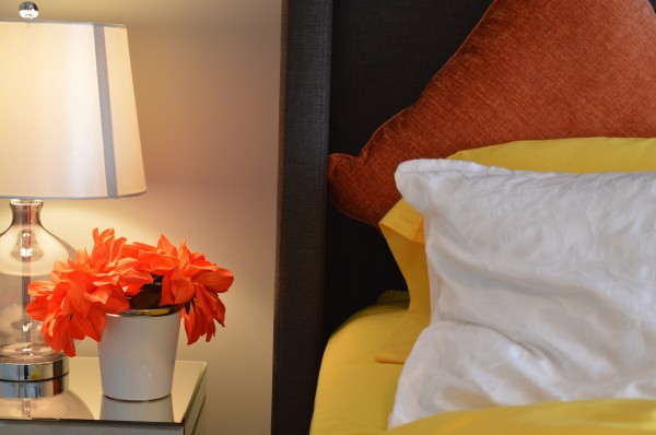 bedside with lamp plant